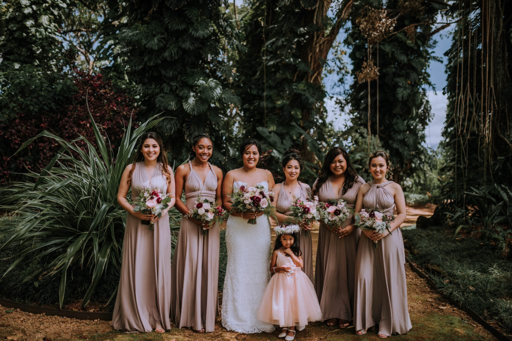 bridal party with pink bridesmaid dresses